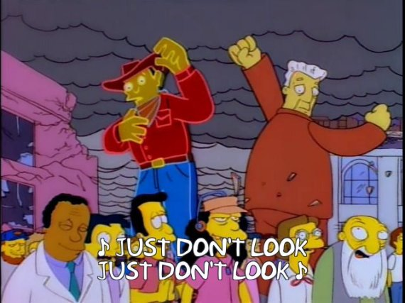 "Simpsons animation of billboard ads wrecking buildings with subtitle ""Just don't look"""